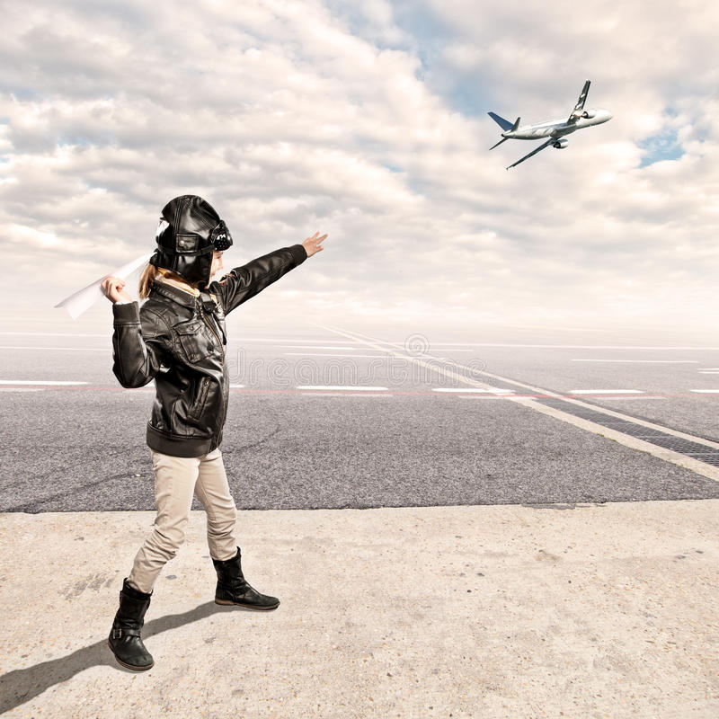 Little aviator. At the airport stock photography