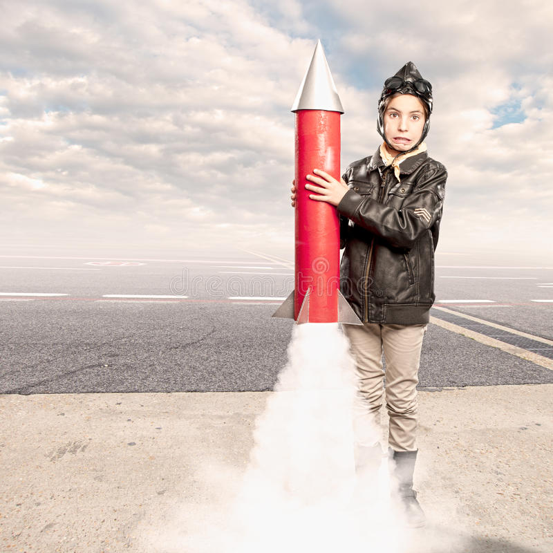 Little aviator holding a rocket. At the airport royalty free stock images
