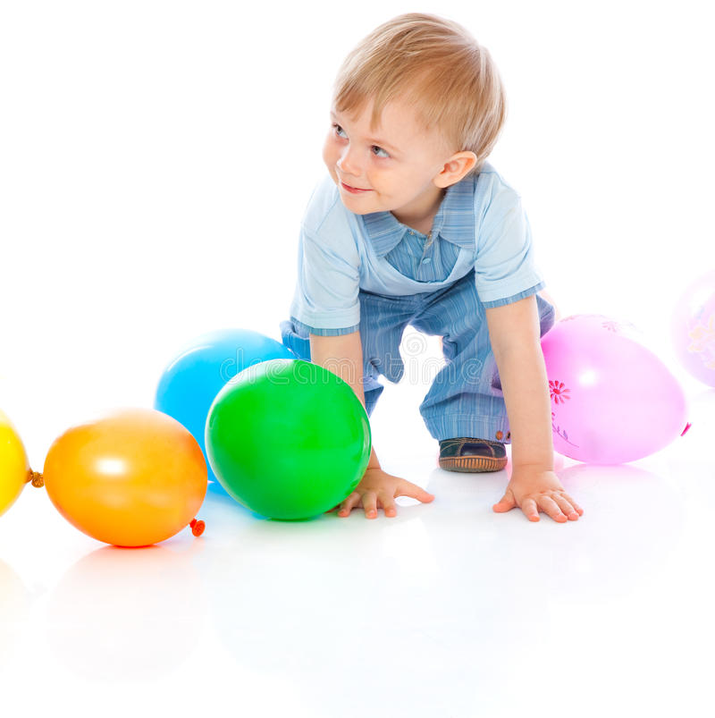 Little baby in balloons royalty free stock photography