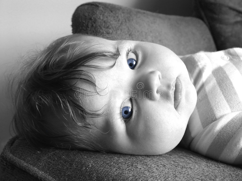 Little baby with blue eyes. Blue eyes royalty free stock image