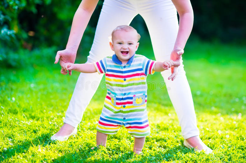 Little baby boy making first steps stock image