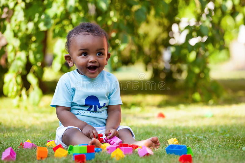 Little baby boy playing in the grass royalty free stock photography