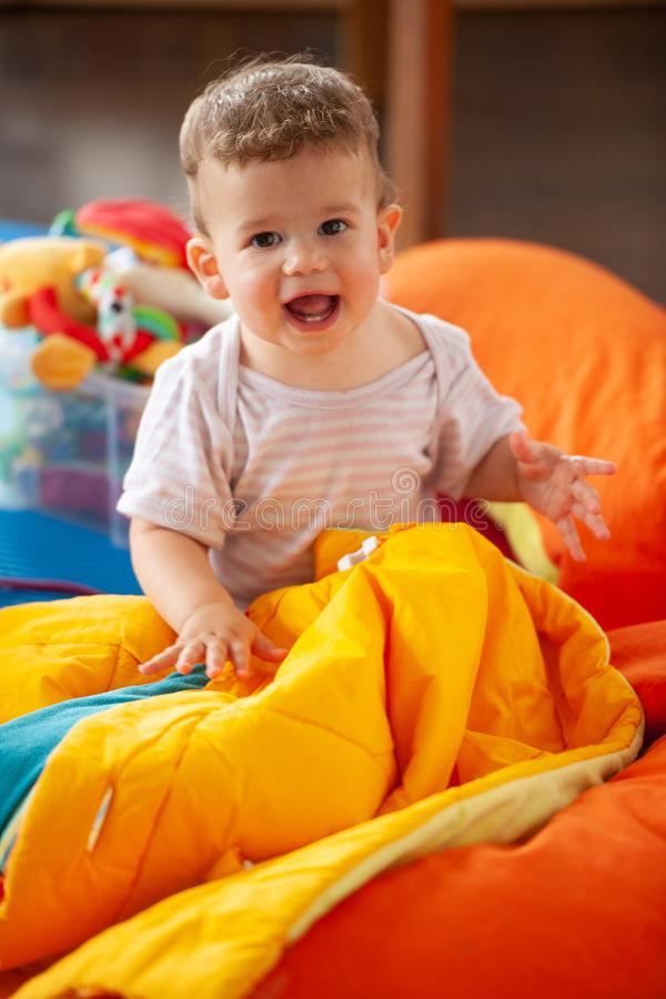 Little baby boy playing in living room on the floor stock photos