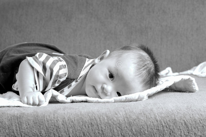 Little baby boy,portrait of adorable curious smile baby boy close up in black and white royalty free stock photography
