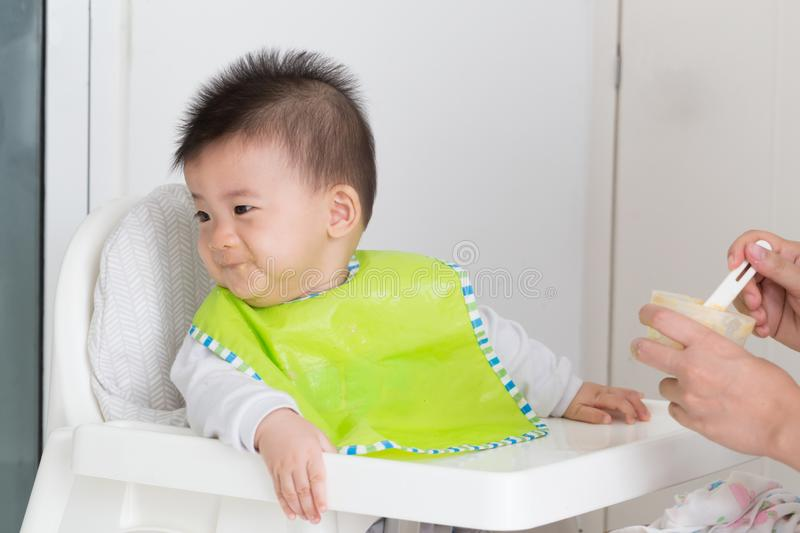 Little baby boy refuses to eat because eating full or not like food. Baby feeding problems concept royalty free stock photos