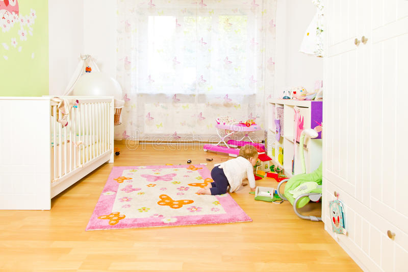 Little baby in children´s room royalty free stock images