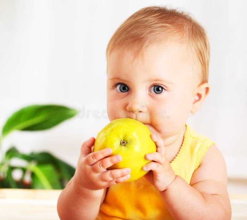 Little baby eating apple stock photo
