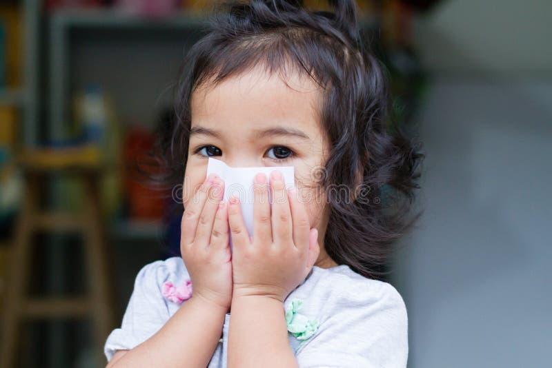 Little baby gag. Little baby girl gag as she sick stock photo