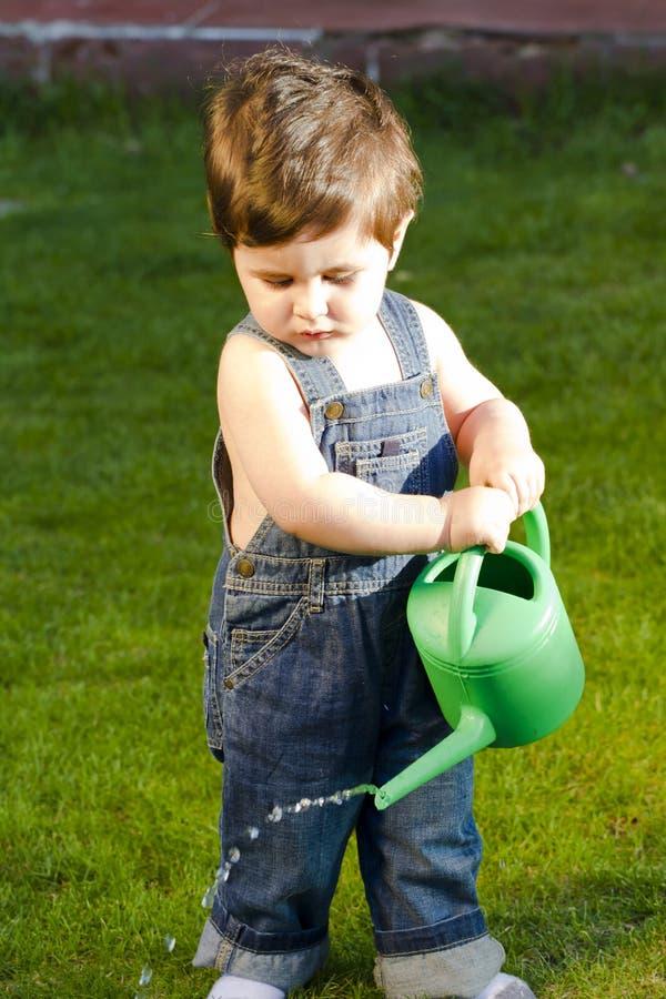 Download Little baby gardener stock image. Image of glasshouse - 20772095