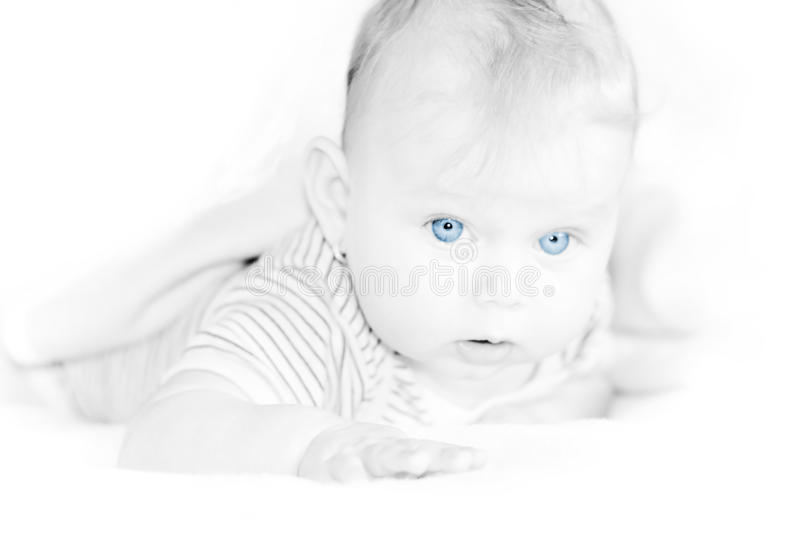 Little Baby Girl With Blue Eyes stock photography