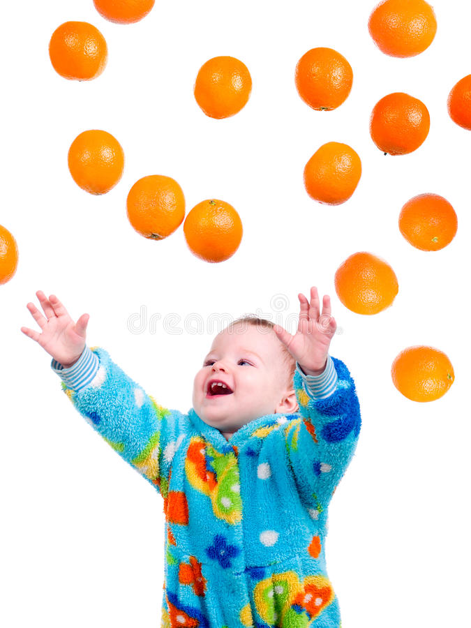 Download Little Baby Girl Caughts Flying Oranges Stock Image - Image: 12223913