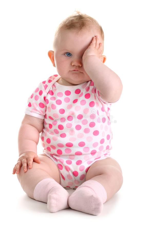Free Little Baby Girl Covers Her Eye With Left Hand Iso Stock Photography - 9706792