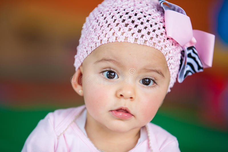 Little baby girl dressed in pink royalty free stock images