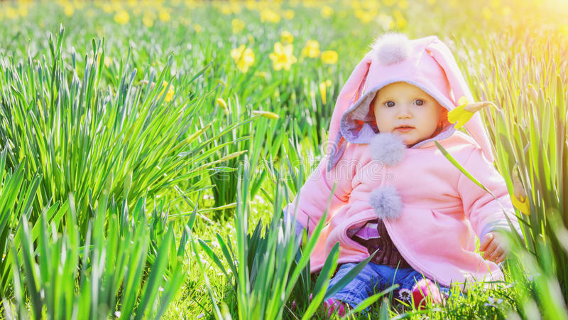 Little baby girl with flowers royalty free stock photography