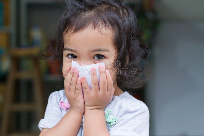 Little baby girl gag. Little girl gag with background bokeh royalty free stock image