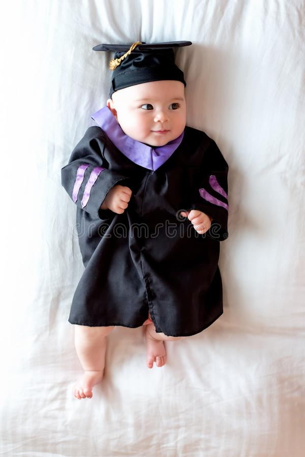 Baby Girl In Graduation Cap And Gown Stock Image - Image of child ...