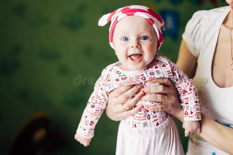 Little baby girl and her mother. Funny baby hat with ears, like a cow. royalty free stock image