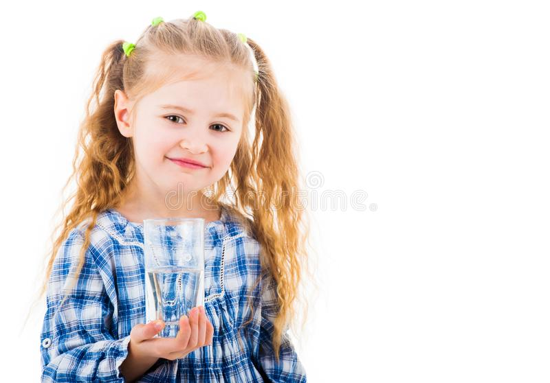 Little baby girl holding a glass of pure water stock photos