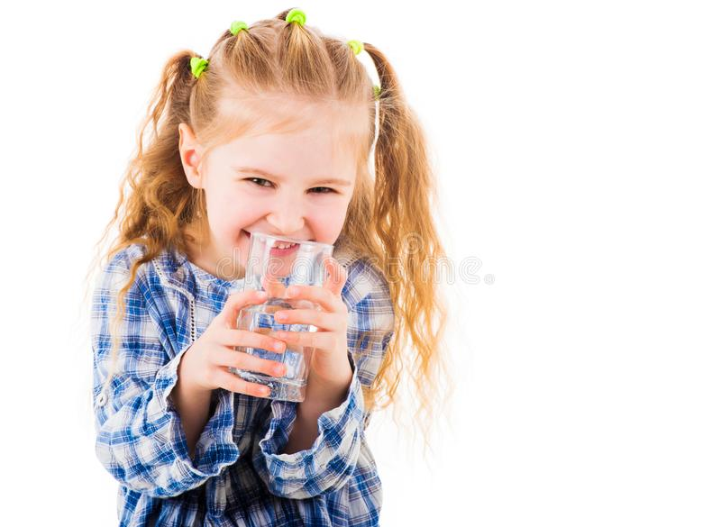 Little baby girl holding a glass of pure water stock photography