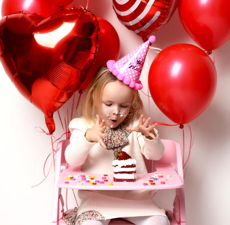 Little baby girl kid celebrate birthday with sweet cake and candies royalty free stock photography