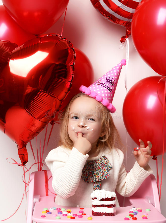 Little baby girl kid celebrate her third birthday with sweet cake on a light party background royalty free stock photos