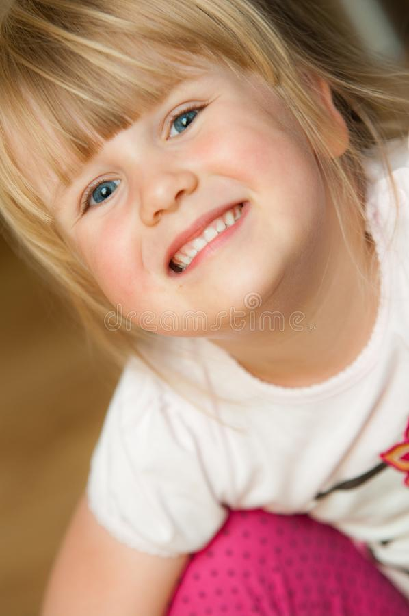 Little baby girl making face portrait royalty free stock photos