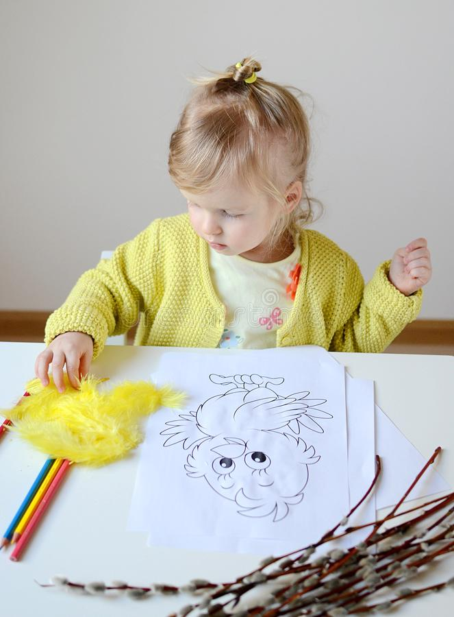 Little baby girl painting at home stock photo