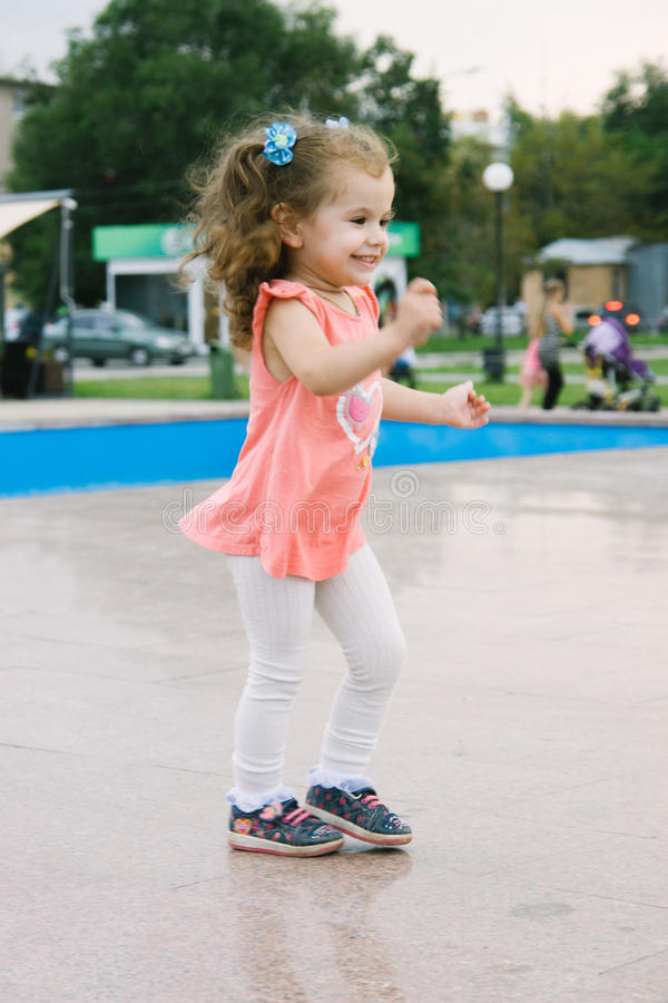 Little baby girl on park dancing royalty free stock photo