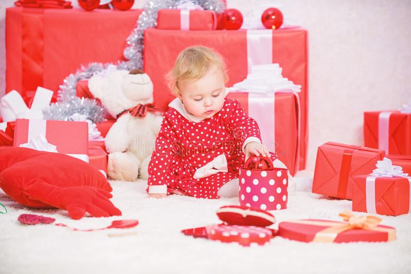 Little baby girl play near pile of gift boxes. Family holiday. Gifts for child first christmas. Christmas activities for. Toddlers. Christmas miracle concept stock photos
