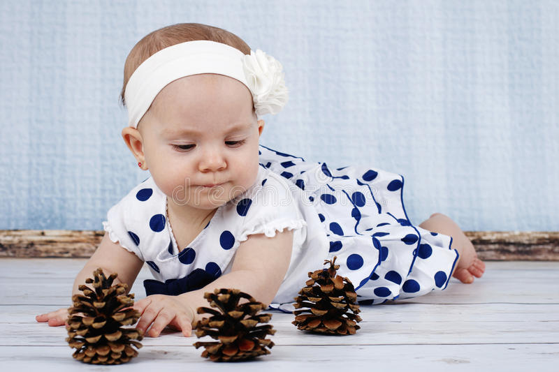 Little baby girl playing with cones royalty free stock images
