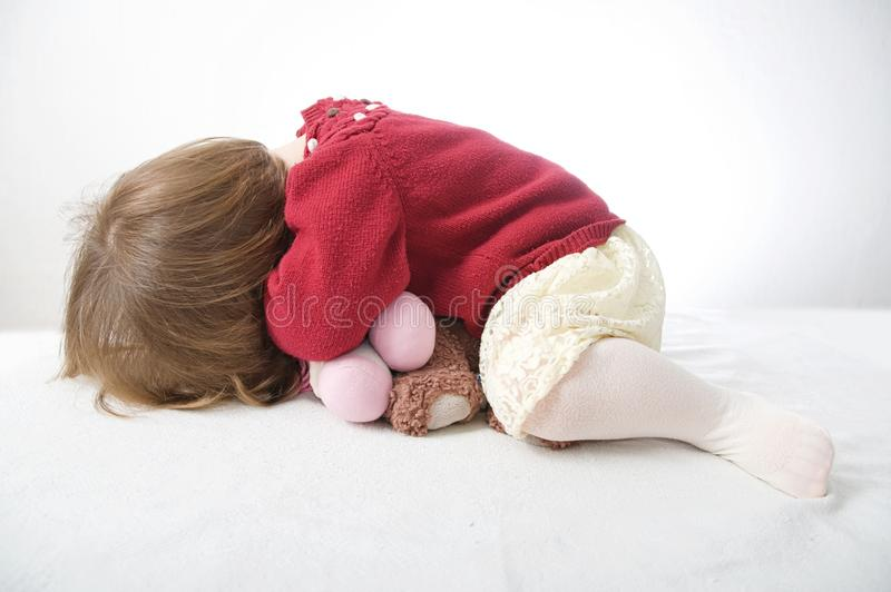 Little baby girl playing hide. cute baby in dress stock image