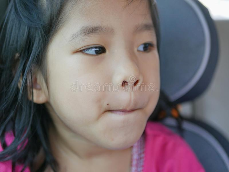 Little baby girl pursing her lips, as she was pondering her thought on something - baby`s facial expression stock photo