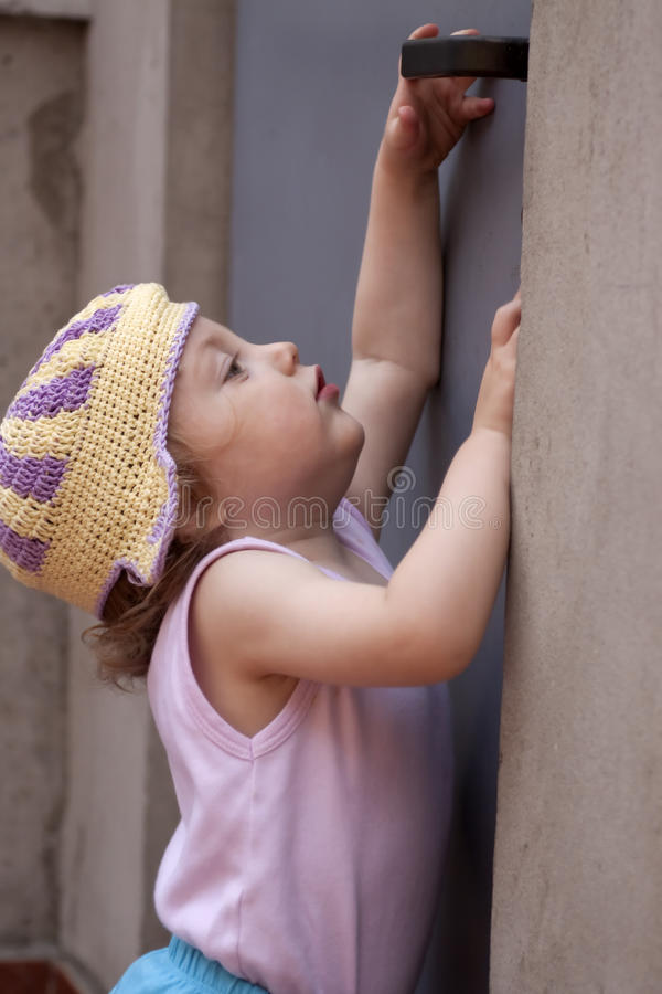 Download Little Baby Girl Reaching For A Door Knob Stock Photography - Image: 10132502