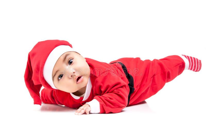 Little baby girl in red Christmas clothes. Isolated on white stock images