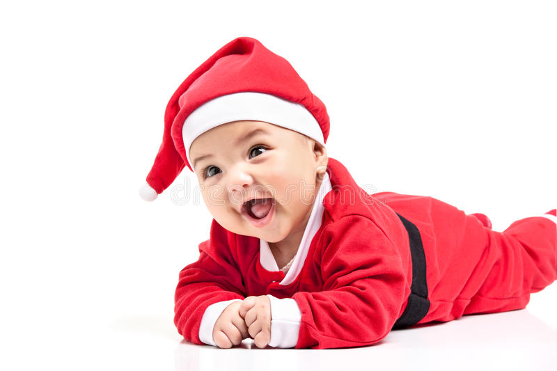 Little baby girl in red Christmas clothes. Isolated on white royalty free stock photo