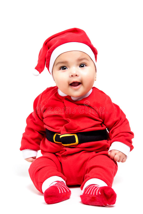 Little baby girl in red Christmas clothes. Isolated on white stock image