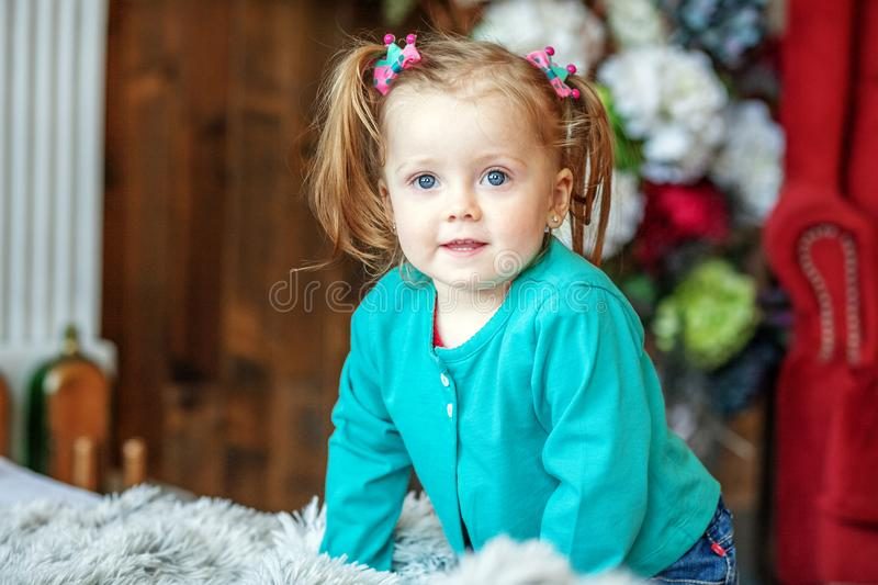 Little baby girl in the room. 1-2 years. The concept of childhoo stock images