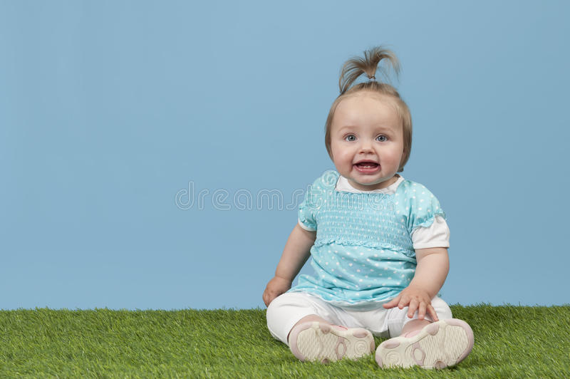 Download Little Baby Girl Seated On Grass Stock Image - Image: 24431483