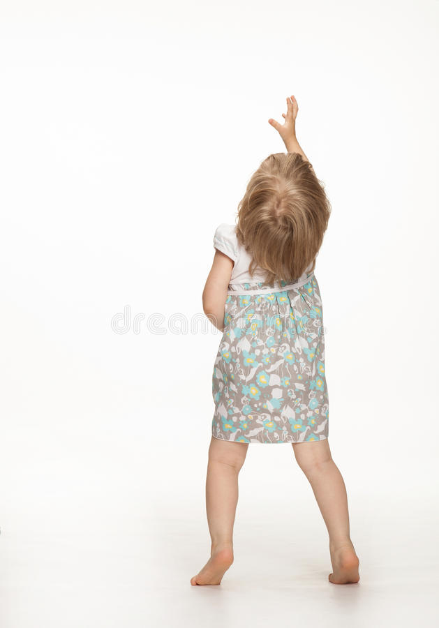 Little baby girl showing something royalty free stock photos