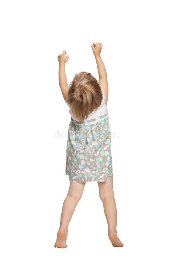 Little baby girl showing something stock photo