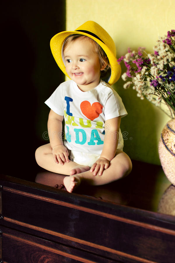 Little baby girl sitting on the dresser stock photos