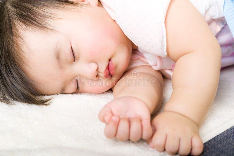 Little baby girl sleeping stock photos