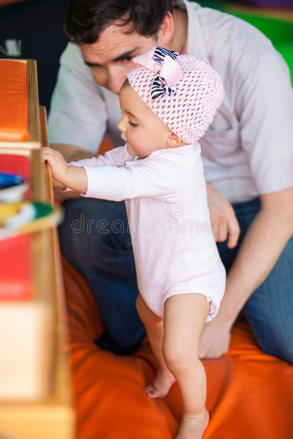Little baby girl standing up royalty free stock photography