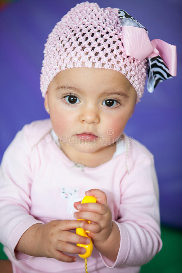 Little baby girl with a toy phone royalty free stock images