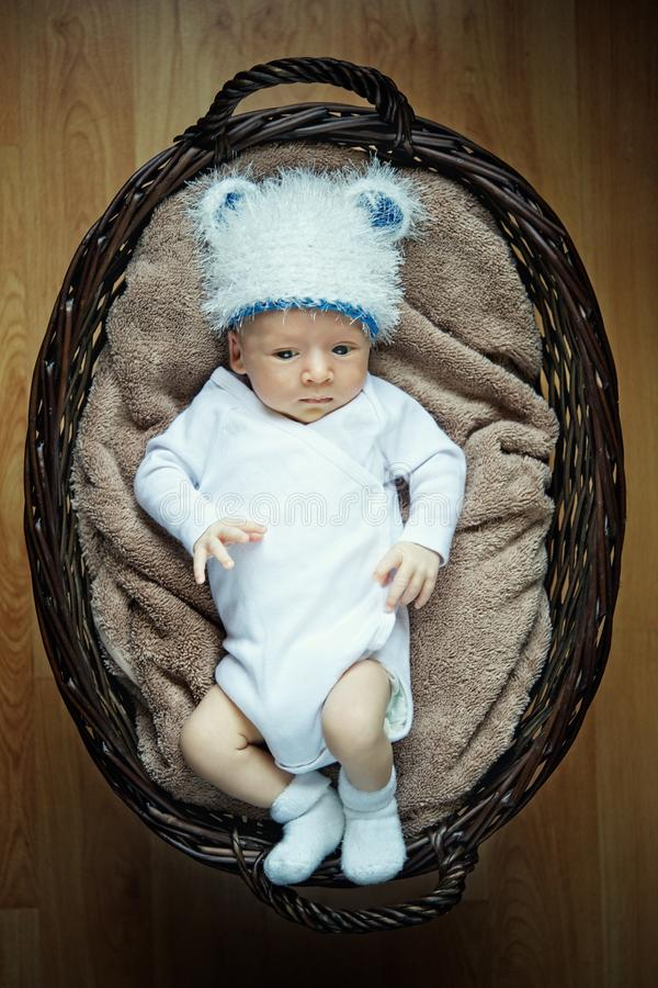 Download Little Baby Lying In Basket. Stock Image - Image: 20927955