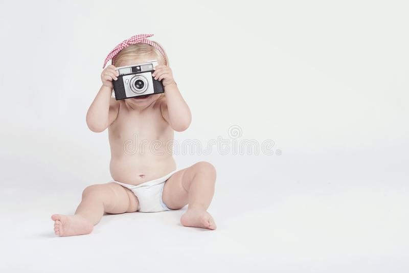 Little baby with photo camera. On white background royalty free stock images