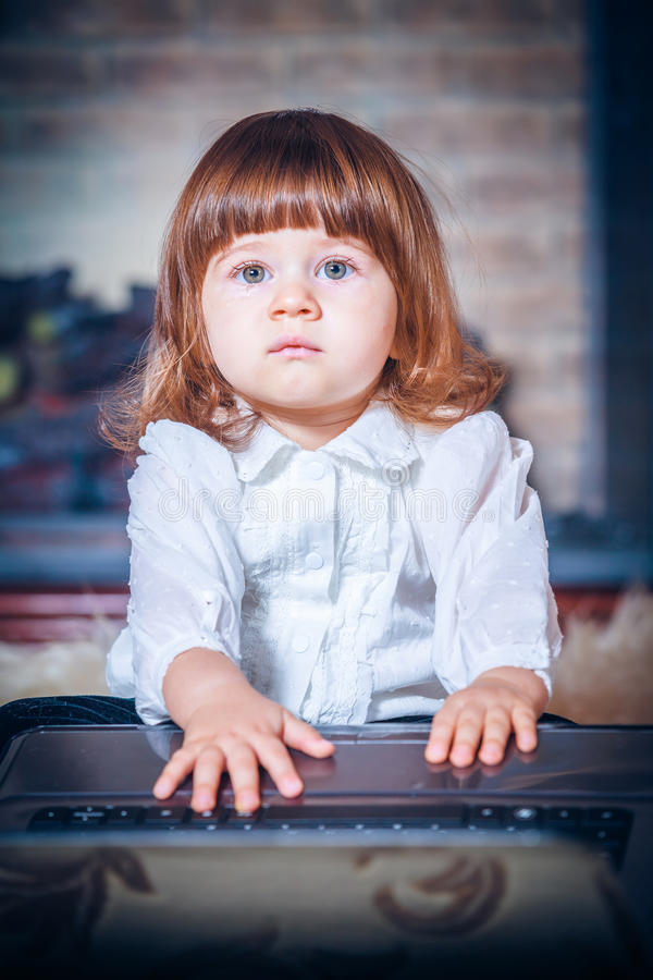 Download Little Baby Playing With Laptop Stock Image - Image of home, caucasian: 28222295
