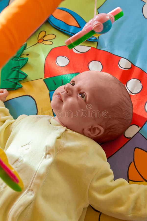 Little Baby Playing On Mat Stock Photography