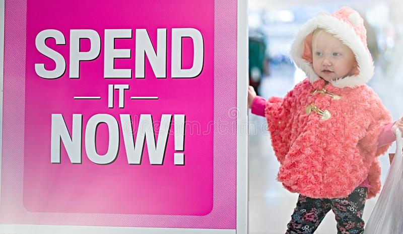 Little baby shopping for gifts in the mall, shopping center . stock photos