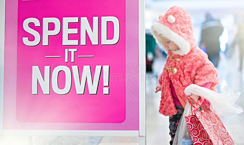 Little baby shopping for gifts in the mall, shopping center . stock photo